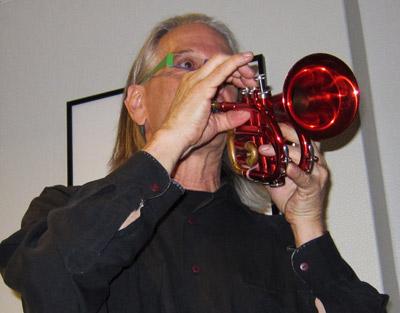 Nik Phelps playing his red trumpet